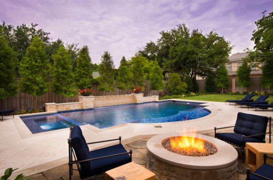 captivating%20home%20exterior%20desin%20feats%20modular%20curved%20swimming%20pool%20and%20permanent%20round%20firepit%20and%20ergonomic%20navy%20blue%20arm%20chairs.jpg